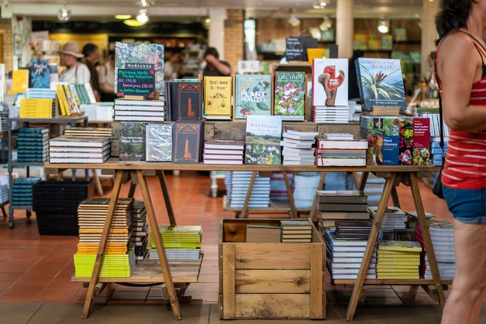 assorted books on a table in a bookstore
