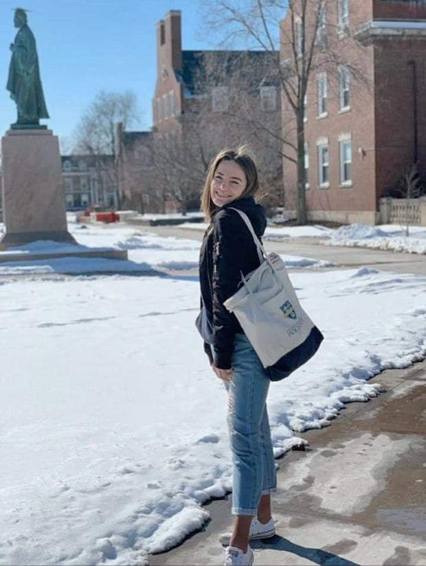 woman in front of Wilson Commons
