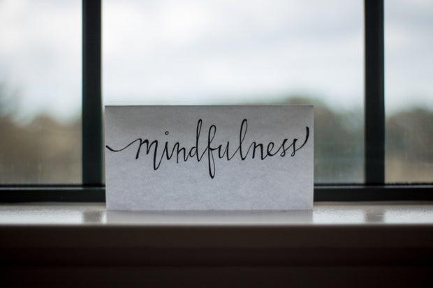 word written on paper in front of window
