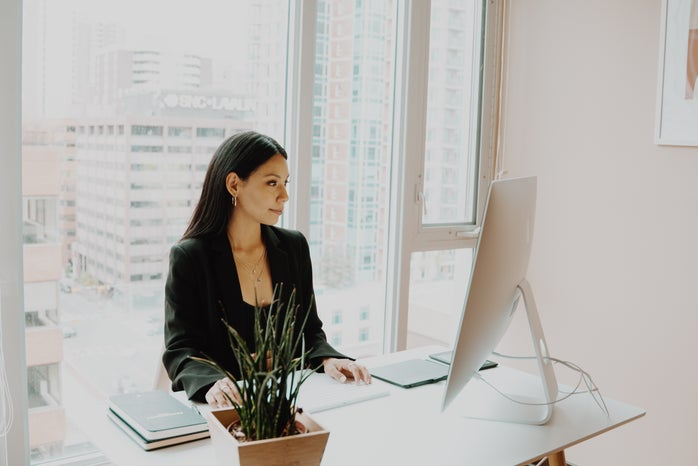A woman sitting at an office desk