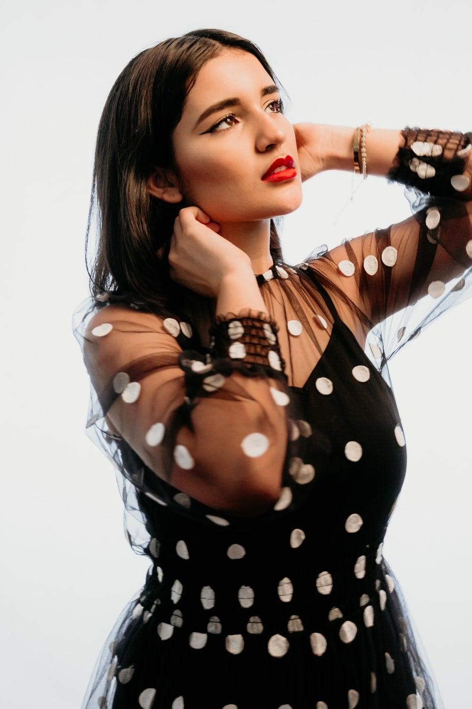 woman in sheer polka dot dress