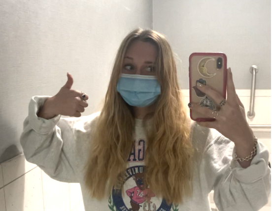 Girl showing hair before a hair cut