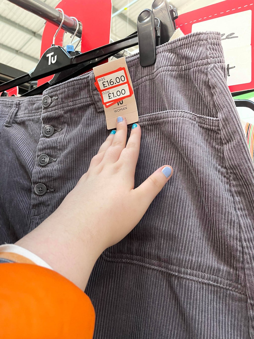 Grey Skirt on hanger with reduced tag on show
