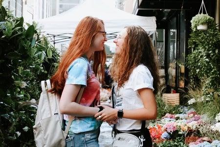 Girlfriend and girlfriend posing at market