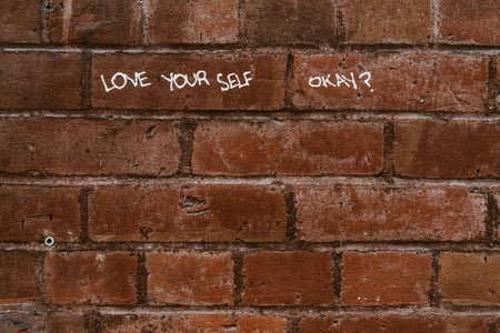 Love yourself written on wall