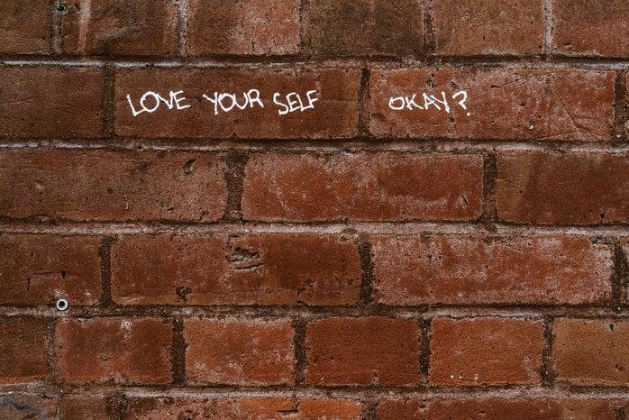 Love yourself written on wall