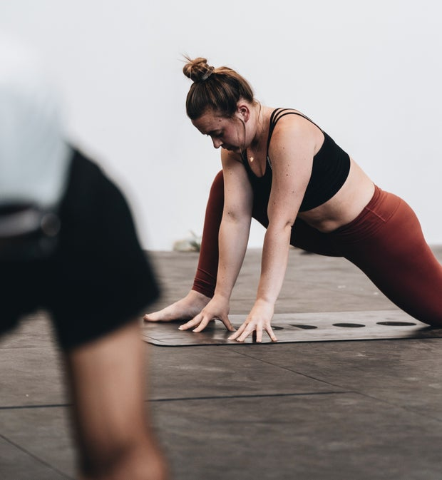 person stretching and exercising