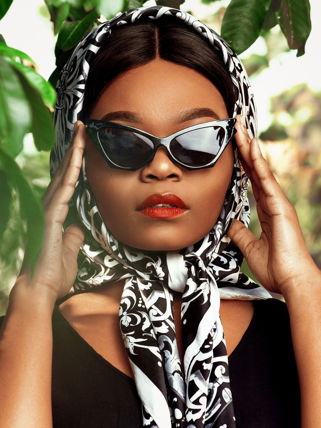 Woman with silk headscarf and sunglasses