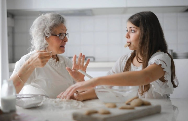 Grandma baking with granddaughter