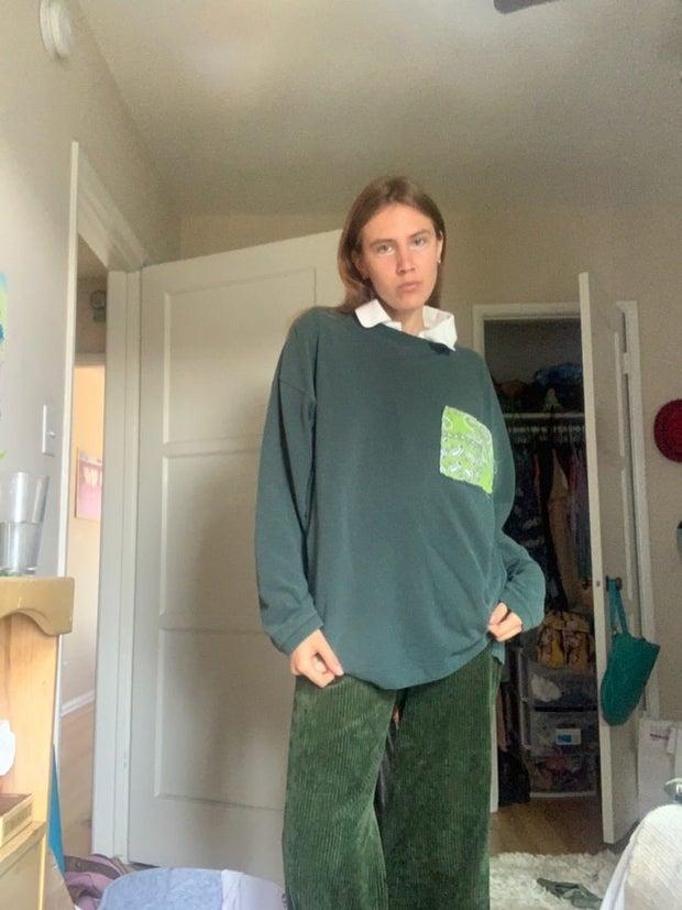 young woman wearing green sweatshirt