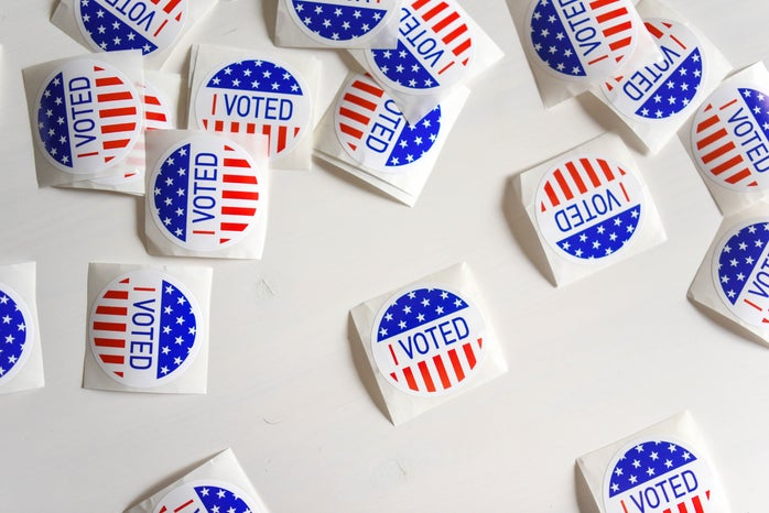 """Lots of \""""I voted\"""" stickers are scattered on a table."""