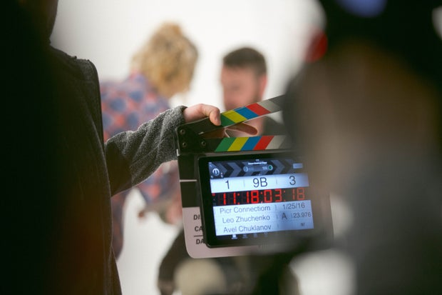 Person with a clap board on set