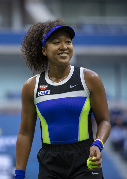 Naomi Osaka smiles during her match against Azarenka in the 2020 US Open Finals hosted in Arthur Ashe Stadium on the grounds of the USTA Billie Jean King National Tennis Center.