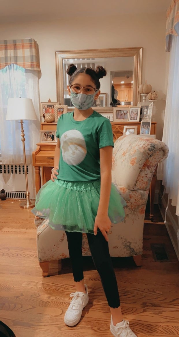 Girl in Care Bear Costume with Mask