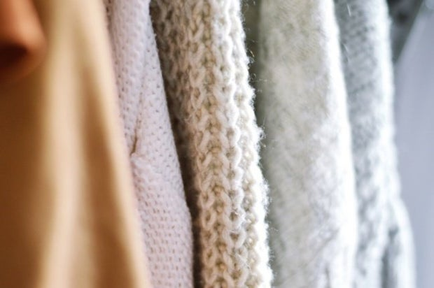 Close up image of sweaters and their knit material texture