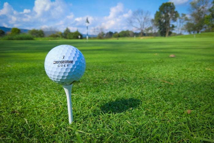 golf ball on tee on golf course