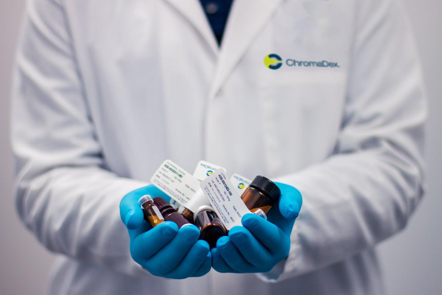 Pharmacist holding medication