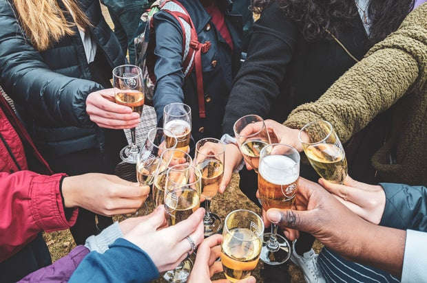 people holding champagne glasses