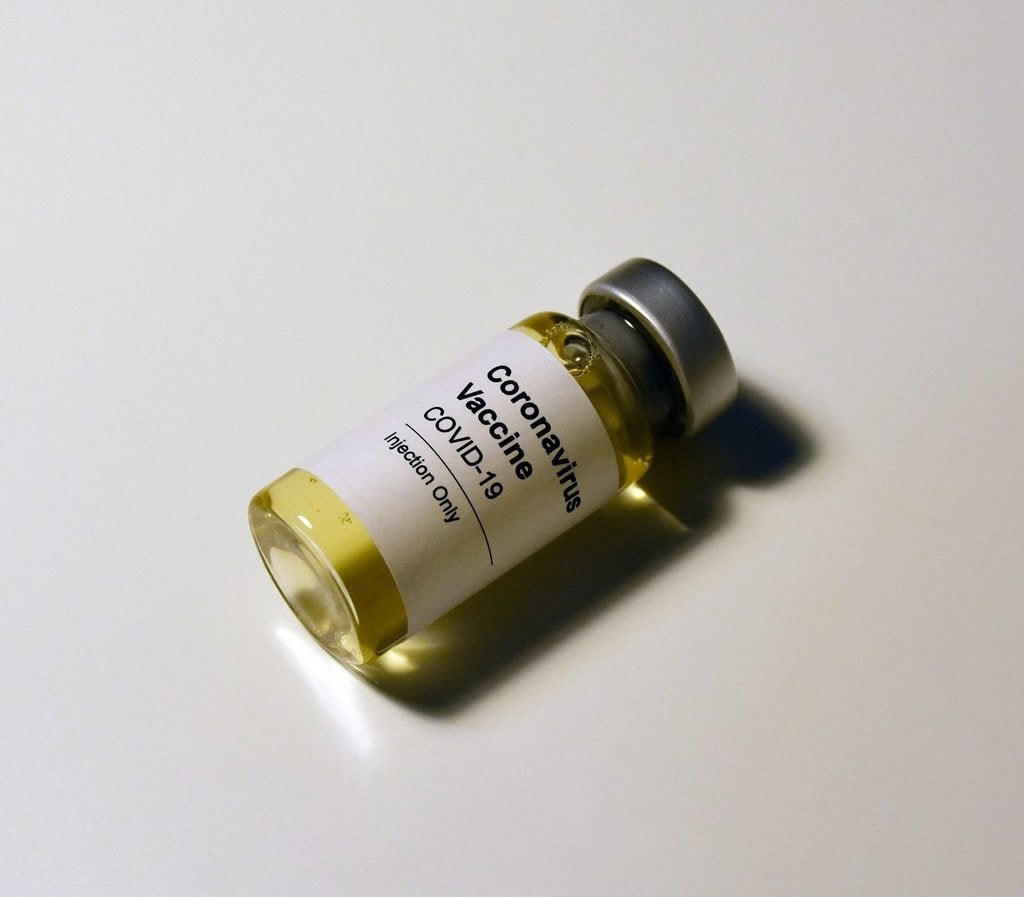 """Pill box labeled \""""Coronavirus Vaccine\"""""""
