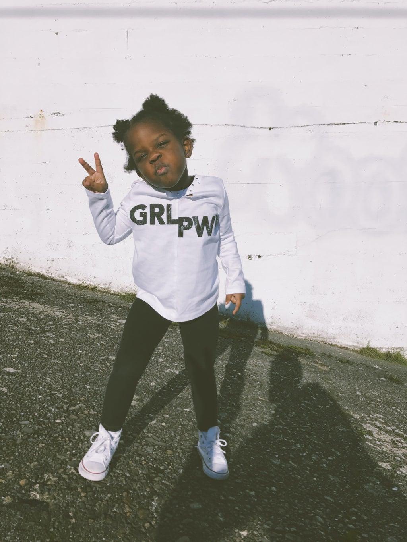 """little girl in \""""GRL PWR\"""" shirt"""