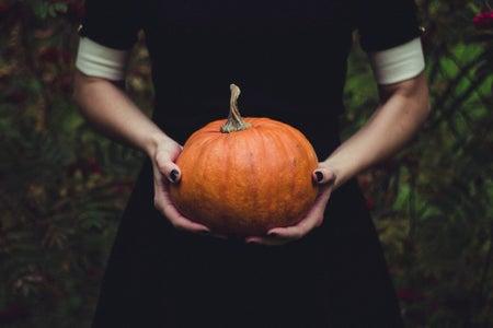 Woman carrying pumpkin