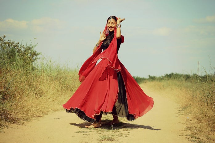 Indian girl dancing in traditional outfit