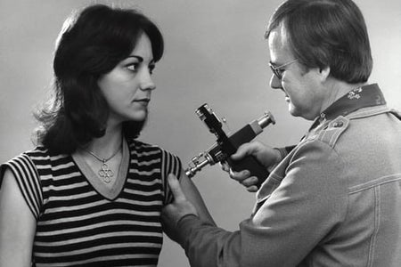 woman receiving swine flu vaccination in 1976