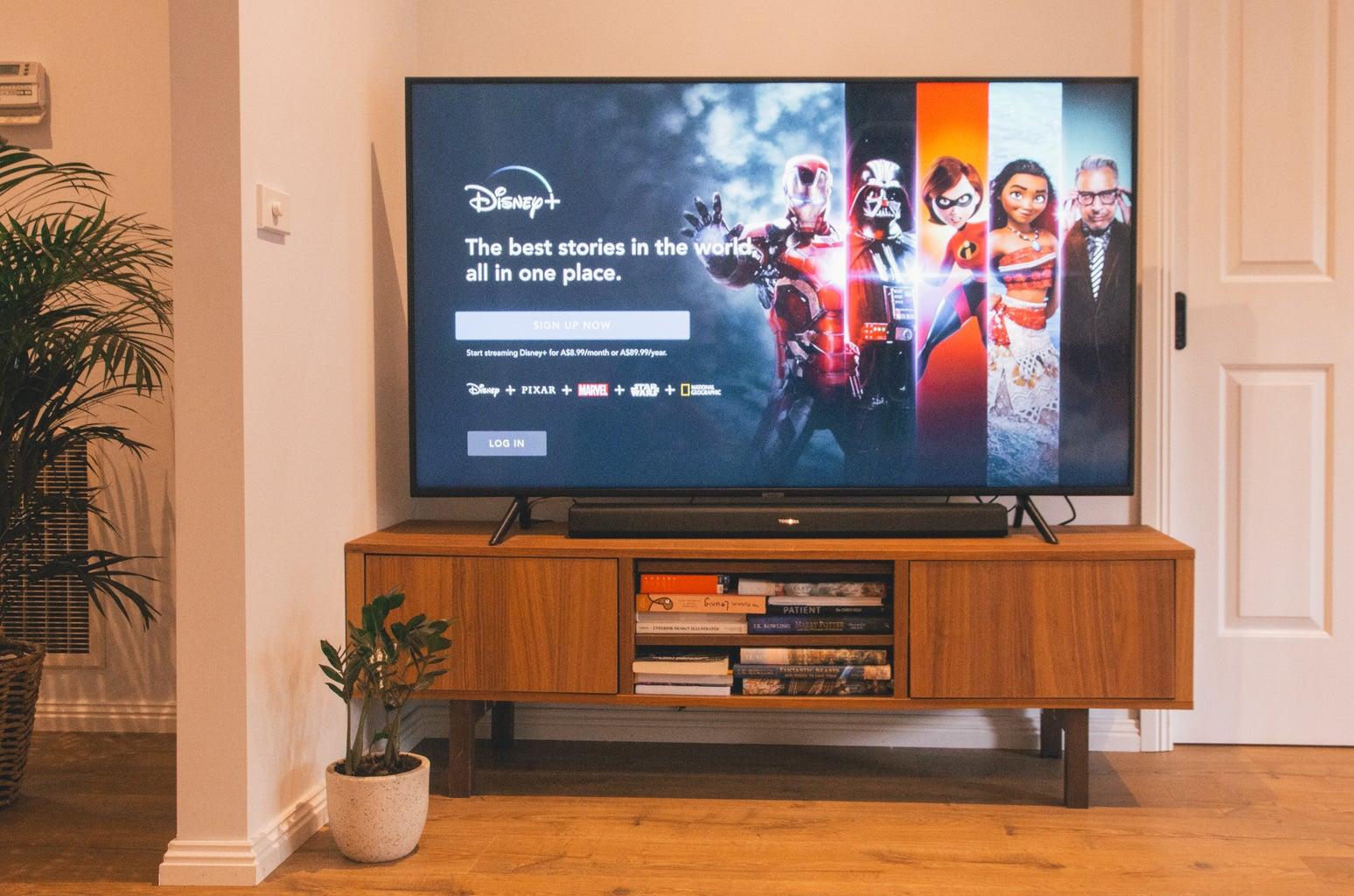 Disney plus on tv on stand showing disney plus