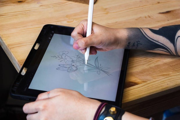 rickie drawing on tablet