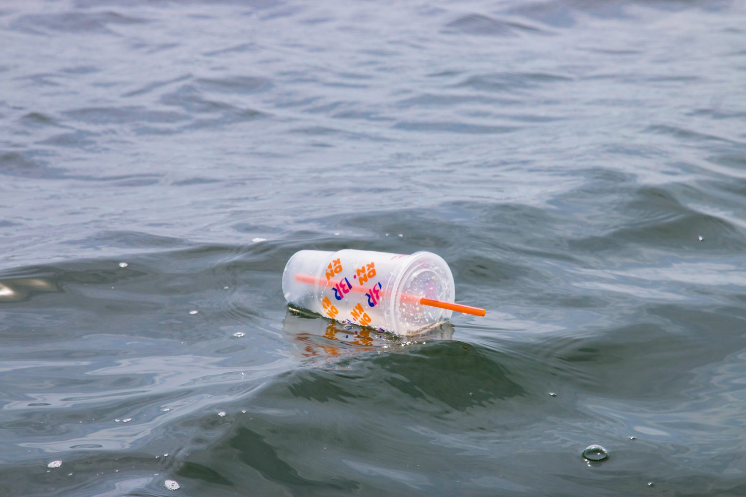 plastic cup floating in water