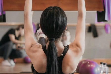 Woman working out for her arms