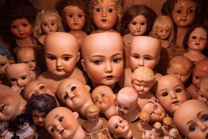 assorted collection of doll heads