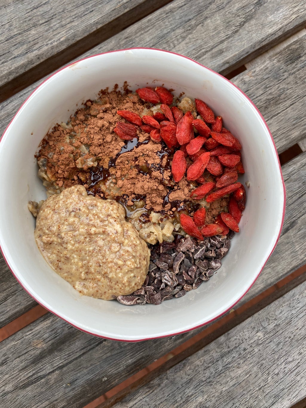 Dorm oatmeal with nut butter, cinnamon, chocolate pieces, and dried fruit