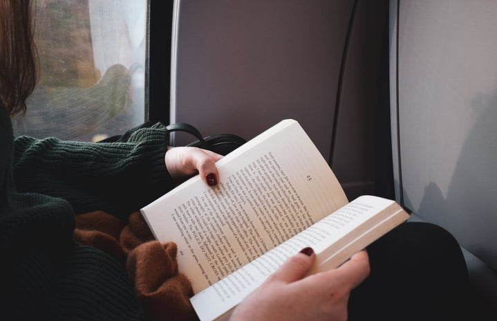 girl reading on train