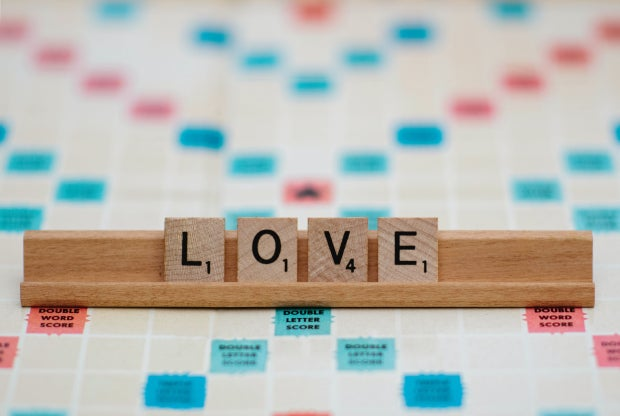Scrabble tiles that spell out love