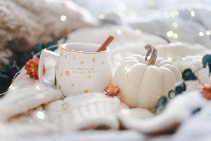 white ceramic coffee mug with white pumpkin