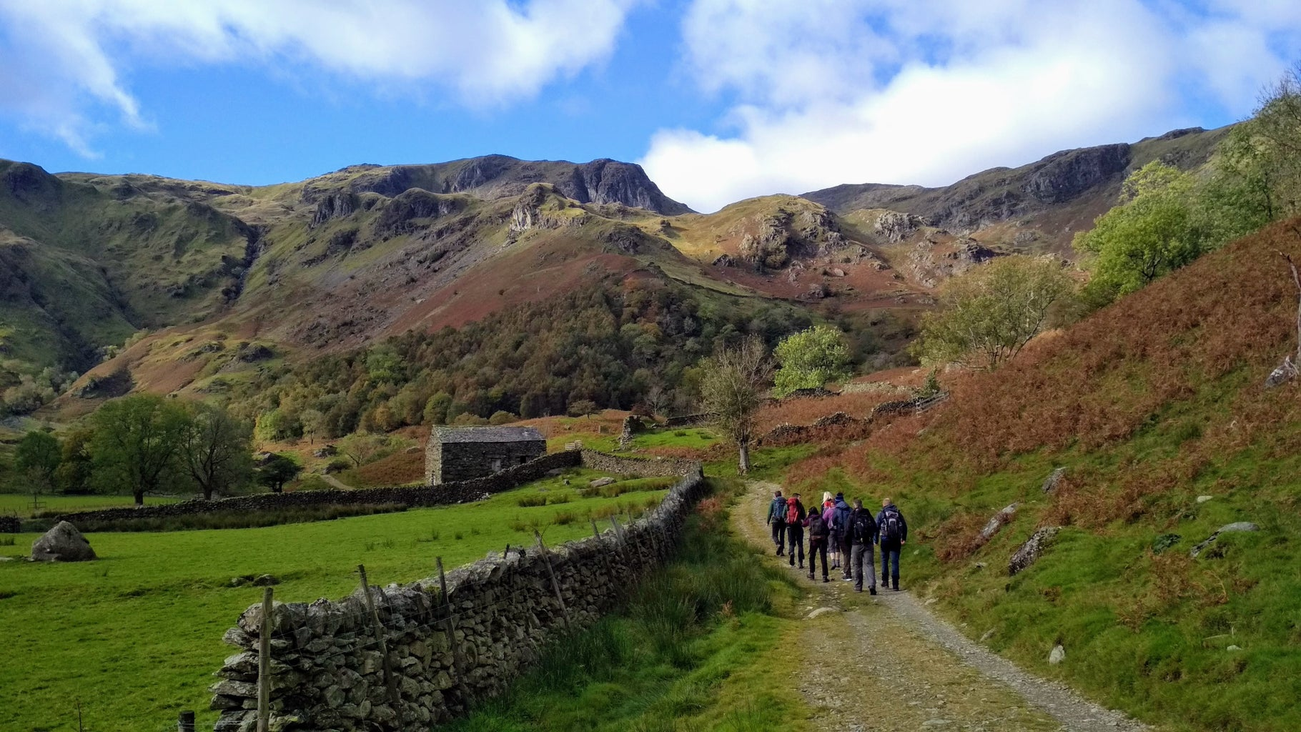 People walking on a trail in the Lake District