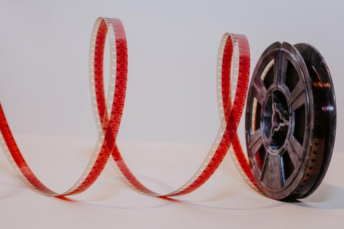 red film reel white background