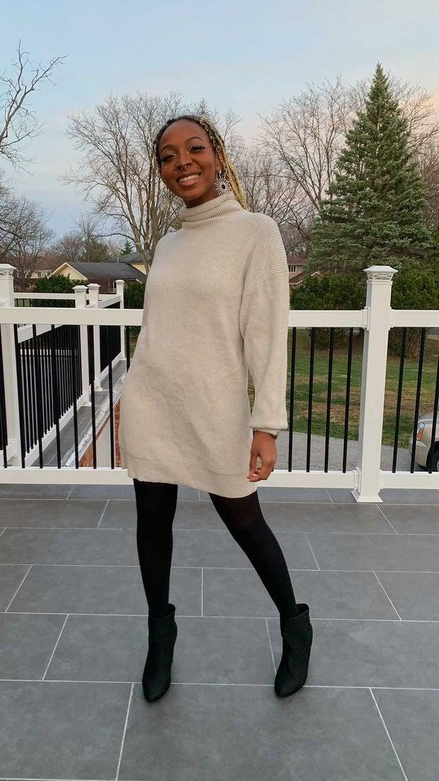 young woman wearing sweater dress