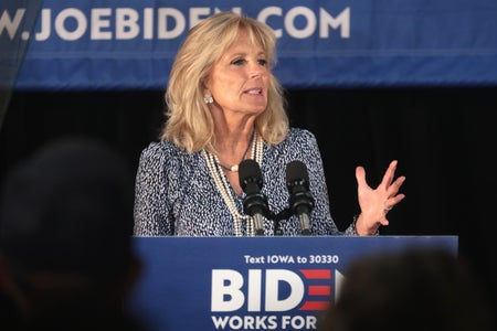 Jill Biden at a podium, speaking out to an audience.