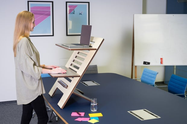 woman working upright on a standing desk