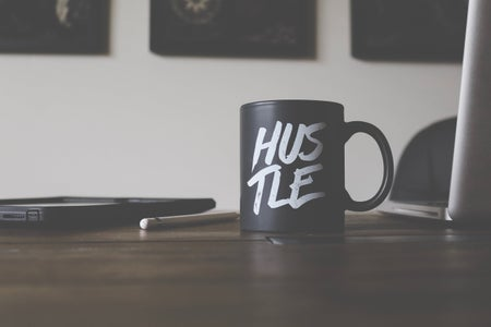 Black and white hustle mug on table