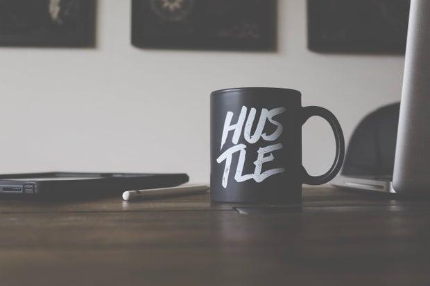 Black and white hustle mug on table