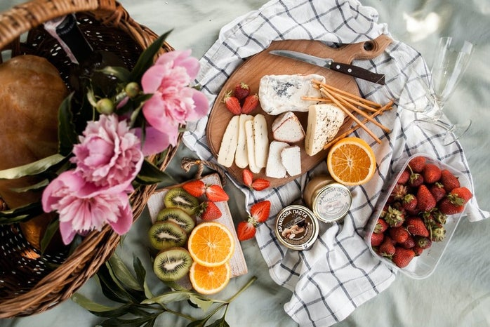 charcuterie board with fruit and cheese