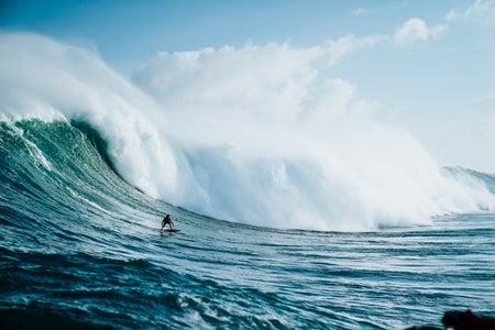 surfing big wave