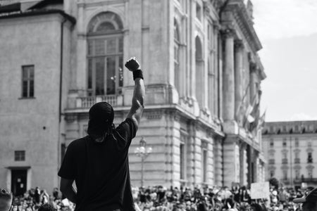 man with his fist up