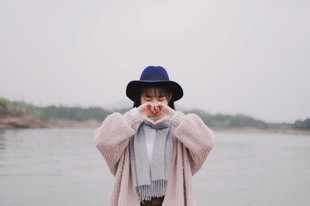 chinese girl with heart hands