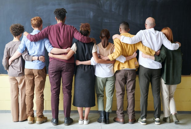 group of people with their arms around each other