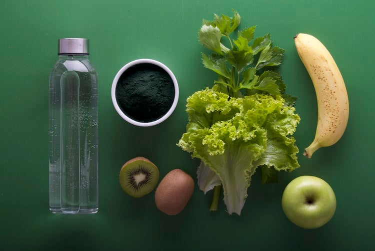 Flatlay of food on green background