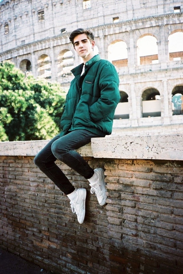 young man wearing green jacket